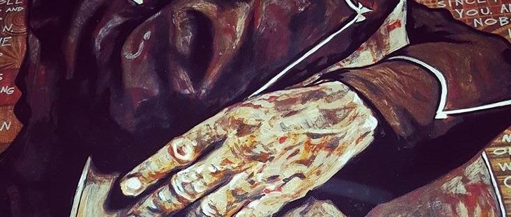 A mural of a man hugging a guitar.